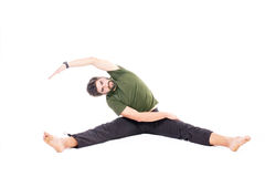 Man in split pose Stock Image