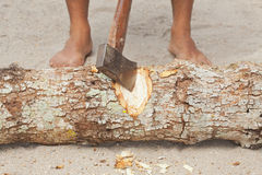 Man splitting wood with an ax Stock Images