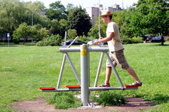 Man in sport. Man is doing exercises outdoors in a park Stock Images