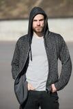 Man sport fashion, bearded guy model in black hoodie Stock Photography