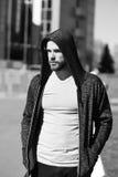 Man sport fashion, bearded guy model in black hoodie Royalty Free Stock Image