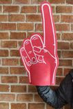 Man with sport number 1 fan glove Royalty Free Stock Photo