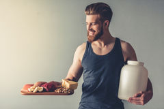 Man with sport nutrition stock photos