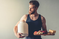 Man with sport nutrition royalty free stock photos