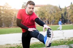 Man sport stretching and warming before his training session Royalty Free Stock Photography