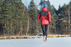 Man during sport trail running race in winter outdoor Royalty Free Stock Image