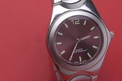 Man sport watch. Close up of a man sport watch on a red background Royalty Free Stock Image
