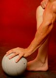 Man with sports ball. Male with sports ball on red Royalty Free Stock Photography
