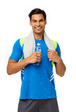 Man In Sports Clothing Holding Water Bottle And Towel Royalty Free Stock Photos