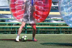 Man on a sports field playing in the bumper ball Royalty Free Stock Photography