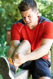 Man With Sports Injury Sustained Whilst Exercising Outdoors Royalty Free Stock Images