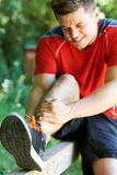 Man With Sports Injury Sustained Whilst Exercising Outdoors Stock Image