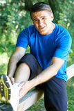 Man With Sports Injury Sustained Whilst Exercising Outdoors Stock Photography