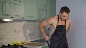 Sexy cook wearing an apron. Man sports, strong, athletic, sexy. Having dressed an apron on a naked body stock video