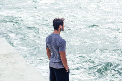Man in sports wear standing near sea Stock Photography