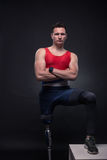 Man sportsman athlete posing, prosthetic leg. One young adult man disabled, sportsman athlete posing, one prosthetic leg, standing Royalty Free Stock Photo