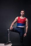 Man sportsman athlete posing, prosthetic leg. One young adult man disabled, sportsman athlete posing, one prosthetic leg, standing Royalty Free Stock Photography