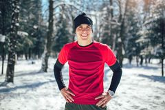 Sportsman Taking Break From Running in Extreme Snow Conditions. Man Sportsman Taking Break From Running in Extreme Snow Conditions Royalty Free Stock Image