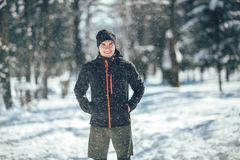 Sportsman Taking Break From Running in Extreme Snow Conditions. Man Sportsman Taking Break From Running in Extreme Snow Conditions Stock Image