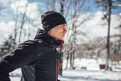 Man Taking Break From Running in Extreme Snow Conditions. Man Sportsman Taking Break From Running in Extreme Snow Conditions Stock Photography