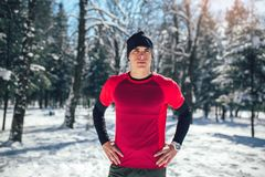 Man Taking Break From Running in Extreme Snow Conditions. Man Sportsman Taking Break From Running in Extreme Snow Conditions Royalty Free Stock Images