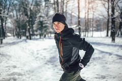 Man Taking Break From Running in Extreme Snow Conditions. Man Sportsman Taking Break From Running in Extreme Snow Conditions Royalty Free Stock Photography