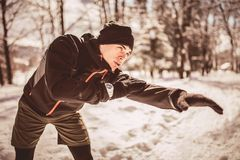 Man Taking Break From Running in Extreme Snow Conditions. Man Sportsman Taking Break From Running in Extreme Snow Conditions Stock Images