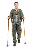 A man in sportswear with backpack and hiking poles Royalty Free Stock Images