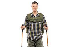 Man in sportswear with backpack and hiking poles Royalty Free Stock Image