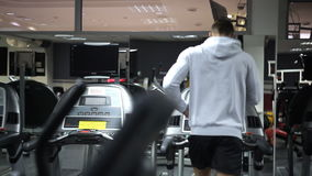 Man in sportswear is engaged on a treadmill in gym. Treadmills are in every gym every fitness center. Classes on treadmill in morning will give most powerful stock video