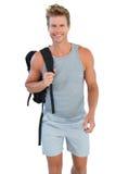 Man in sportswear holding rucksack Royalty Free Stock Photo