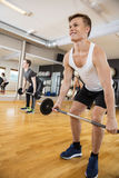 Man In Sportswear Lifting Barbell In Gym Royalty Free Stock Image