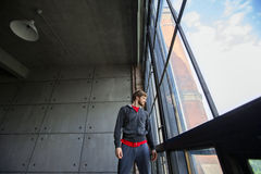 Man in sportswear looking out the window Royalty Free Stock Image