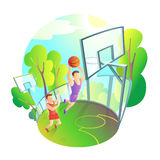 Man in sportswear playing basketball on outdoor playground. Athlete actively throwing the ball in the basket Royalty Free Stock Image