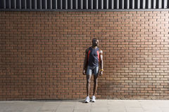 Man In Sportswear Standing Against Brick Wall Royalty Free Stock Photo