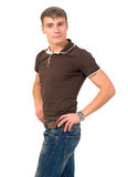 A man in a sporty style isolated. Sporty man in a polo shirt and jeans isolated Stock Images