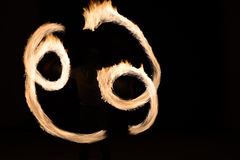 Man sppining fire poi in Thailand Stock Images