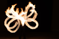 Man sppining fire poi in Thailand Stock Photography