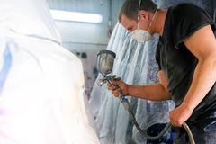 Man with a spray gun in his hand stock image