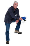 Man with a spray gun Royalty Free Stock Image