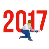 Man with sprayer writes number 2017 - new year concept. Man with sprayer writes number 2017. Painter draw a holiday graffiti. New year concept for card or poster Stock Photo