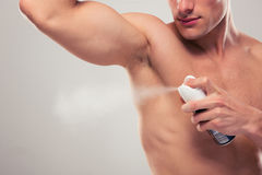 Man spraying deodorant Royalty Free Stock Photo