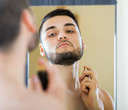 Man spraying fragrance perfume Stock Photo