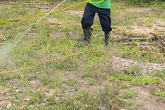 Spraying herbicide. A man is spraying herbicide in fram Royalty Free Stock Photography
