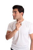 Man spraying perfume cologne to his neck Royalty Free Stock Image