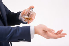 Man spraying perfume on his wrist Stock Photography