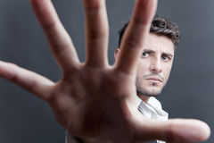 Man with spread hand. Portrait of man with outstretched hand and spread fingers stock images