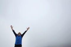 Man spreading hands. A man spreading hands on top of the mountain called Grobnicke Alpe in Grobnik, Rijeka, Croatia Stock Image
