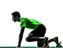 Man sprinter runner in starting blocks silhouette Royalty Free Stock Image