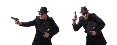 Man spy with handgun isolated on white background. The man spy with handgun isolated on white background royalty free stock photography